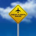 bigstock-cheap-flights-ahead-road-sign-20797673