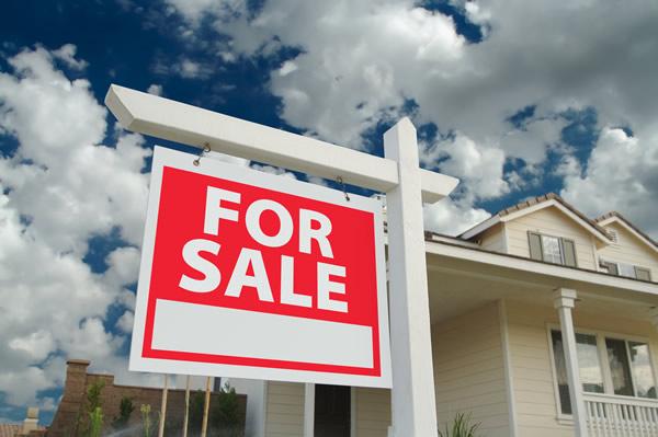 Real_Estate_for_sale_sign_insert_via_bigstock