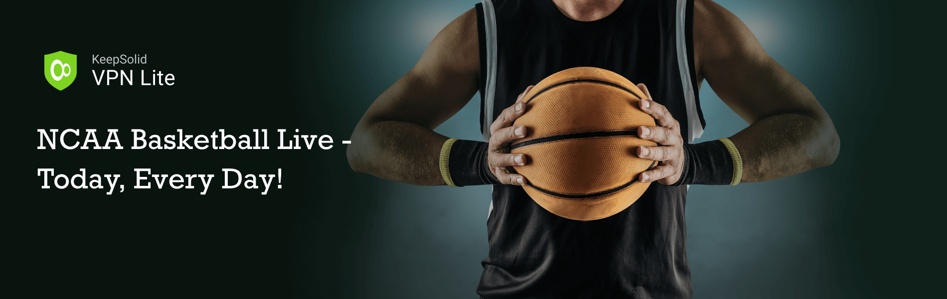 Watch NCAA Basketball Live. Basketball in a male hands, player in black with orange sport ball